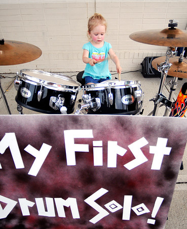John P. Cleary | The Herald Bulletin<br /> Two year-old Sofie Shofner has fun player her first drum solo while at the Community Safety Fair at Mounds Mall. Playing the drums was one of many activities for kids to do during the 4-hour event Wednesday.