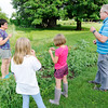 Don Knight | The Herald Bulletin<br /> Bev and Roger Sharritt and two girls they are hosting through Safe Families of Madison County enjoy peas picked fresh from their garden. Safe Families provides temporary homes to children who need them.