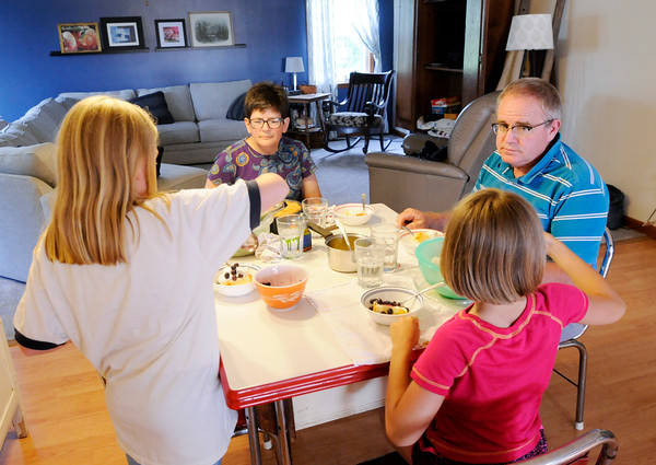 Don Knight   The Herald Bulletin<br /> Bev and Roger Sharritt and two girls they are hosting through Safe Families of Madison County enjoy dessert after eating dinner. Safe Families provides temporary homes to children who need them.