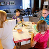 Don Knight | The Herald Bulletin<br /> Bev and Roger Sharritt and two girls they are hosting through Safe Families of Madison County enjoy dessert after eating dinner. Safe Families provides temporary homes to children who need them.