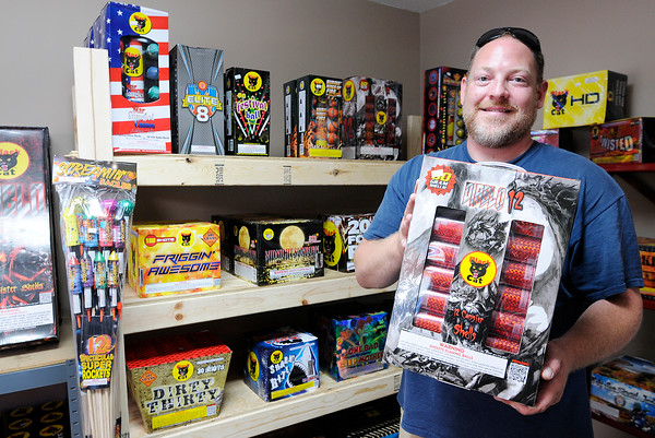 Don Knight | The Herald Bulletin<br /> Nick Lockhart holds a box of Black Cat shells at Jem's Little Shop of Boom at 2149 E CR 67.