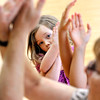 John P. Cleary | The Herald Bulletin<br /> Sailor O'Brien, 5, tries to follow yoga instructor Bianca McRae as she shows a pose that intertwines the arms during the Fun with Yoga program for children at the Anderson Public Library Tuesday.