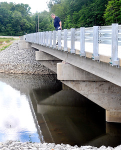 John P. Cleary | The Herald Bulletin Madison County Commissioner Jeff Hardin looks over the new bridge over Killbuck Creek Tuesday after the span on County Road 450 North was dedicated. The old steel bridge was closed to traffic in 2001 due to safety concerns.