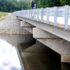 John P. Cleary   The Herald Bulletin<br /> Madison County Commissioner Jeff Hardin looks over the new bridge over Killbuck Creek Tuesday after the span on County Road 450 North was dedicated. The old steel bridge was closed to traffic in 2001 due to safety concerns.