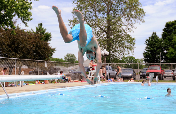 Don Knight | The Herald Bulletin<br /> Chandler Pflugh from Frankton dives into the Alexandria city pool on Thursday. Alexandria's pool is open every day of the summer season from Noon to 6 p.m. with the exception of the week of the 4-H Fair.