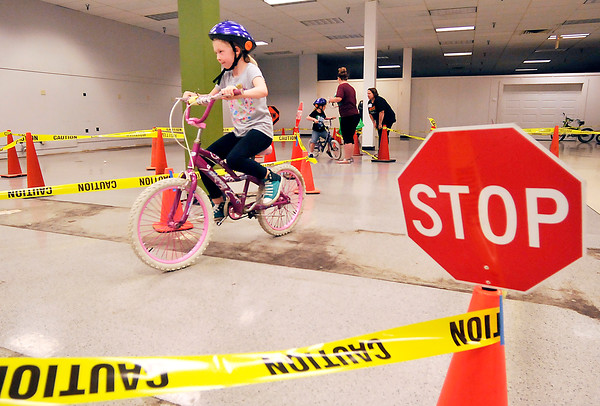 John P. Cleary | The Herald Bulletin<br /> Kids at the Community Safety Fair participated in a bike rodeo where they attended a safety class,  received a free helmet, then were able to ride a bike through a course practicing the bike safety they have learned.