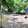 John P. Cleary | The Herald Bulletin<br /> Josh Shugart, from Marion, makes his par throw on the third hole of Elwood's disc golf course on South P Street.