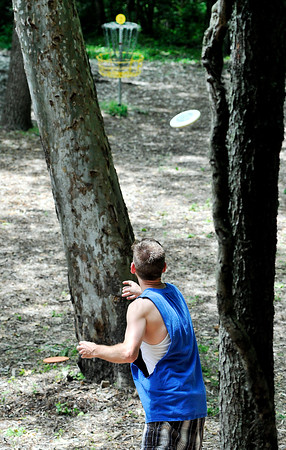 John P. Cleary   The Herald Bulletin<br /> Josh Shugart, from Marion, makes his second shot through trees on the second hole of Elwood's disc golf course on South P Street.