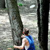 John P. Cleary | The Herald Bulletin<br /> Josh Shugart, from Marion, makes his second shot through trees on the second hole of Elwood's disc golf course on South P Street.
