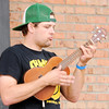 Don Knight | The Herald Bulletin<br /> Jason Wuerfel plays ukulele as the Ukuwailers entertain the crowd during Anderson On Tap at the Dickmann Town Center park on Saturday.