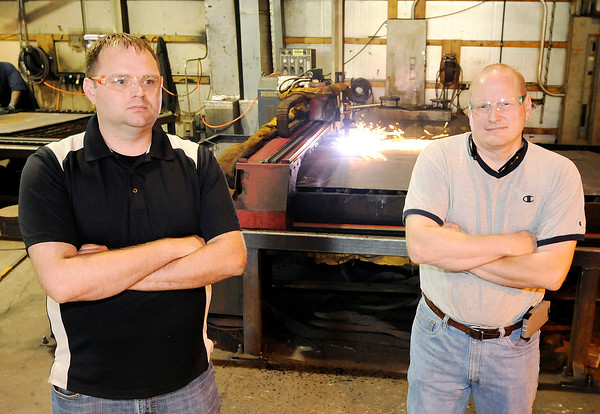 Don Knight | The Herald Bulletin<br /> Co-owners of Steel-Mart are from left Aaron Smith and Rob Pape. In need of space Steel-Mart is moving into the building left vacant by Steel Slitting when they  went out of business when their largest customer, Carrier, announced plans to move to Mexico.