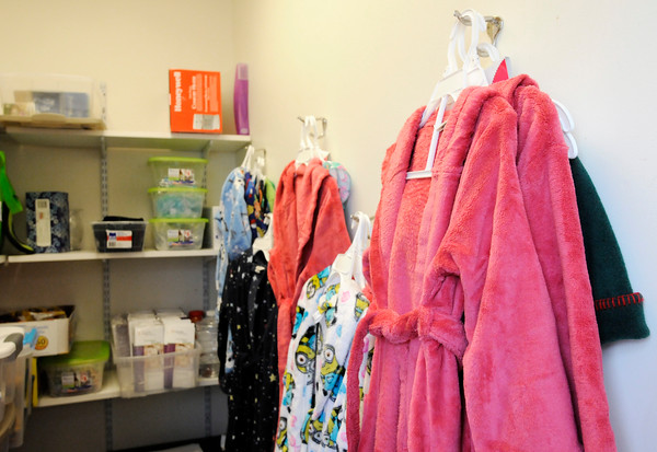 Don Knight | The Herald Bulletin<br /> Community's Sexual Assault Treatment Center depends on donations of bath robes, stuffed animals and snacks to comfort pediatric patients who visit Community's Sexual Assault Treatment Center. Sara Woolum raised $243 to purchase items for the center and presented a check for $5,000 for the center she won through Fox 59's Pay It Forward contest.