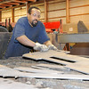 Don Knight | The Herald Bulletin<br /> Antoine Turner removes a piece of cut steal from a plasma cutting table at Steel-Mart in Alexandria on Thursday. When Turner got out of prison four years ago he decided to turn his life around but not many companies will hire someone with a felony record but Madison County's Steel-Mart him a chance to start over.