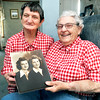John P. Cleary | The Herald Bulletin<br /> Margaret June Clark and twin sister Martha Gene Lambert will celebrate their 90th birthday on June 21st. Here they hold a photograph of themselves when that were 20 years old.