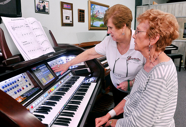 John P. Cleary |  The Herald Bulletin<br /> Judy Lambert, of Lambert's Music Center, helps Dorthy Russell, of Lapel, adjust the setting on the electronic organ before she plays her selection during the weekly Friends playing for Friends gathering at Lambert's Music Center.<br /> <br />   <br /> <br /> Music students playing for each other at Lambert's Music Center.