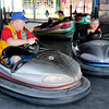 Don Knight | The Herald Bulletin<br /> Jim Richey, left, bumps into his granddaughter Madilene Agee, 7, while riding the bumper cars at the Middletown Lions Club Fair on Friday. The fair wraps up today (Saturday) with Today's Elvis Scotty Zion, the crowning of the queen and an adult tricycle race.