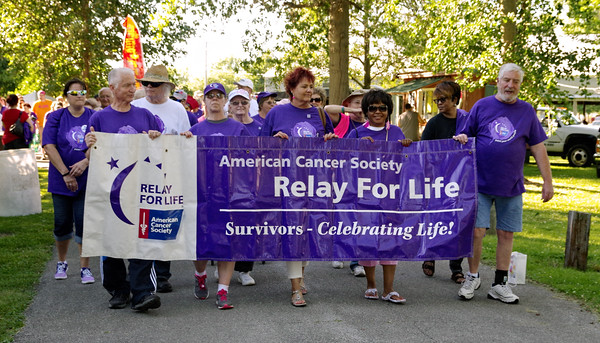 Cancer survivors lead the first lap around Alexandria's Beulah Park to kick-off the Relay for Life on Friday evening.