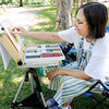 Don Knight | The Herald Bulletin<br /> Artist Tamara Brown finishes a pastel of the Bronnenberg home at Mounds State Park on Saturday. Brown is visiting six state parks as part of the Arts in the Park series.