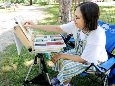 Don Knight | The Herald Bulletin Artist Tamara Brown finishes a pastel of the Bronnenberg home at Mounds State Park on Saturday. Brown is visiting six state parks as part of the Arts in the Park series.