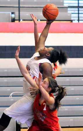 John P. Cleary   The Herald Bulletin<br /> Anderson's Kenigia Hamilton goes high for a rebound in one of the Girls Indiana Class Basketball All-Star Classic games featuring juniors.  Hamilton scored five points and pulled down five rebounds during her time in the game.