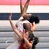 John P. Cleary | The Herald Bulletin<br /> Anderson's Kenigia Hamilton goes high for a rebound in one of the Girls Indiana Class Basketball All-Star Classic games featuring juniors.  Hamilton scored five points and pulled down five rebounds during her time in the game.