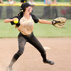 Don Knight | The Herald Bulletin<br /> Madison-Grant's Katie Ailes makes the throw to first after fielding the ball as the Argylls defeated Wapahani to win the regional.