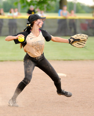 Don Knight   The Herald Bulletin<br /> Madison-Grant's Katie Ailes makes the throw to first after fielding the ball as the Argylls defeated Wapahani to win the regional.