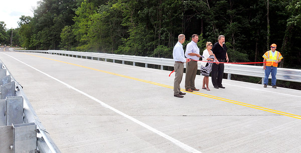 John P. Cleary | The Herald Bulletin The Madison County Commissioners cut a ribbon Tuesday to officially open bridge No. 97 over Killbuck Creek on County Road 450 North. This stretch of road has been closed since 2001 because the old steel bridge, built in 1910, was deemed unsafe for traffic.