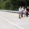 John P. Cleary | The Herald Bulletin<br /> The Madison County Commissioners cut a ribbon Tuesday to officially open bridge No. 97 over Killbuck Creek on County Road 450 North. This stretch of road has been closed since 2001 because the old steel bridge, built in 1910, was deemed unsafe for traffic.