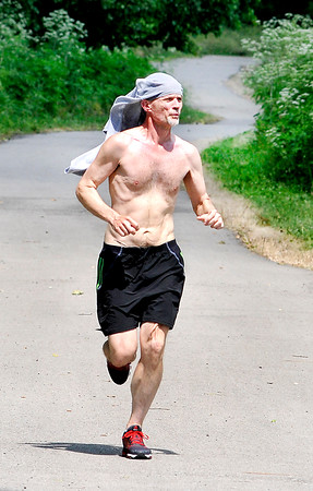 John P. Cleary | The Herald Bulletin<br /> Jogger Phil Fights runs along the Anderson trail system through River Bend Park on the westside of Anderson Thursday afternoon. Fights says he enjoys this section of the trail system and runs it multiple times a week.