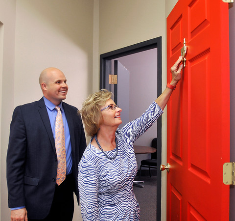 John P. Cleary   The Herald Bulletin<br /> Indiana Secretary of State Connie Lawson knocks on the Door of Opportunity in the Madison County Chamber offices while there for a presentation.