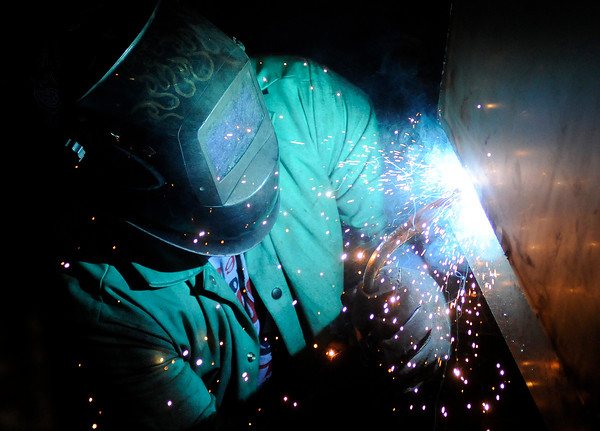 Don Knight | The Herald Bulletin<br /> David Hedgecraft welds a self-dumping hopper at Steel-Mart in Alexandria. The growing company needs more space and is moving to a larger building in Elwood.
