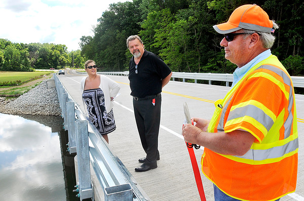 John P. Cleary | The Herald Bulletin<br /> County Commissioners Steffanie Owens and Jeff Hardin look over the new bridge over Killbuck Creek with county engineer Chuck Leser after a dedication ceremony Tuesday morning. This stretch of CR 450 North has been closed since 2001.