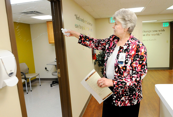 Don Knight   The Herald Bulletin<br /> Sister Eileen Wrobleski blesses the new location for the Open Door Health Services clinic in the Holy Cross Medical Arts Building on Tuesday.