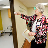 Don Knight | The Herald Bulletin<br /> Sister Eileen Wrobleski blesses the new location for the Open Door Health Services clinic in the Holy Cross Medical Arts Building on Tuesday.