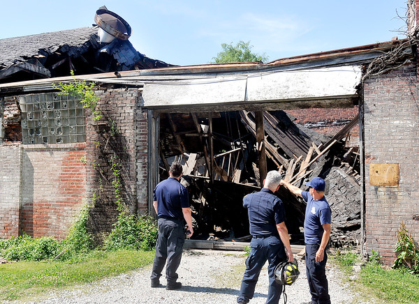 John P. Cleary   The Herald Bulletin<br /> Anderson Fire Department personnel check out the damage from a partial roof collapse of the old factory building at 1500 West 2nd Street that Anderson Transit System uses as their school bus garage.