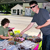 Mark Maynard | for The Herald Bulletin<br /> Tony Cox, co-owner of BC Fireworks, makes a purchase from Morgan Pickering during the Stepping Stones for Veterans bake sale at his store on Saturday.