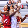 John P. Cleary | The Herald Bulletin<br /> Anderson's Kenigia Hamilton, right, fights for position to get a rebound during one of the Girls Indiana Class Basketball All-Star Classic games featuring juniors being played at AU.