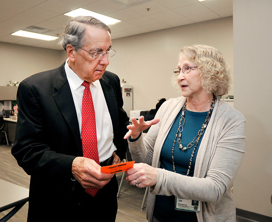 John P. Cleary | The Herald Bulletin<br /> Tom Snyder, president of Ivy Tech Community College, talks with Marvel Johnson the tutor coordinator for the 60th Street campus.