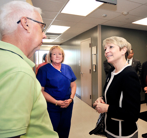 John P. Cleary | The Herald Bulletin<br /> Ivy Tech president Sue Ellspermann, right, talks with dentist Dr. Ron Wolf and Joyce Hudson, Dental Hygiene Program Chair, as she tours the Anderson Ivy Tech campuses Monday afternoon.