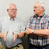 Don Knight | The Herald Bulletin<br /> From left, Roger Chezem and Ed Hanlon share memories about their years at St. Ambrose as alumni returned for the last 6th grade class to graduate before their consolidation next year with St. Mary's to become Holy Cross.