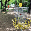 John P. Cleary | The Herald Bulletin<br /> Curtis Vest, from Marion, follows his shot toward the basket on hole #1 at the Elwood disc golf course.