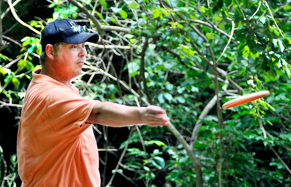 John P. Cleary   The Herald Bulletin<br /> Curtis Vest, from Marion, lets a shot go as he plays the Elwood disc golf course.
