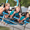 John P. Cleary | The Herald Bulletin<br /> Ileah Clark, center,12, tries to blow a bubble while riding the Hang Glider with her friends Avery Mollenkopf , 12, and Alivia Swisher, 11,  Tuesday evening at the opening night of the Lions Club June Jamboree at Falls Park in Pendleton.<br /> The fair runs through Saturday.