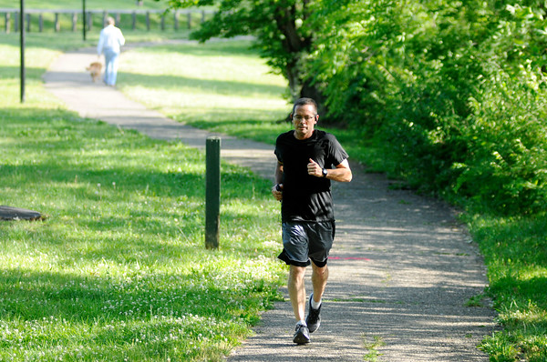 Don Knight   The Herald Bulletin<br /> A jogger runs on the trails at Shadyside Park on Wednesday. Kyle James with California based Alta Planning said Monday during a public forum at the Mill Creek Civic Center that 89,000 people reside within three miles of the proposed Mounds Greenway trail system.