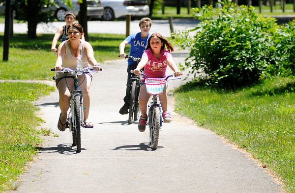 Don Knight | The Herald Bulletin<br /> Bicyclists ride the trails at Shadyside Park on Wednesday. A study of the proposed Mounds Greenway shows as many as 62,000 tourists from outside the Madison and Delaware county area will be attracted to the development.