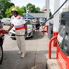 Don Knight | The Herald Bulletin<br /> Robert Collier of Anderson pumps $5 in free gas at the Anderson Pantry on Madison Avenue Thursday. Motorists waited in long lines as USA Insulation was giving $5 in gas to home owners for filling out a questionnaire.