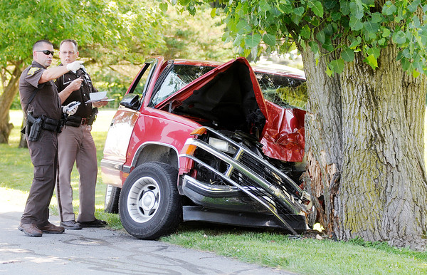Don Knight | The Herald Bulletin<br /> The Sheriff's Department investigates the scene of an accident were the driver of a truck struck a tree on County Road 300 East between 200 and 250 North Saturday afternoon.