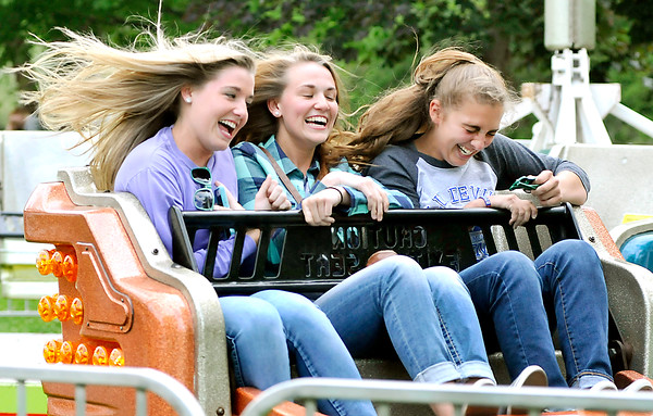 John P. Cleary   The Herald Bulletin<br /> Laurn Landes, 16, Morgan Landes, 19, and Sam Hammel, 17, are all smiles as they, and their hair, gets whipped around while riding the Sizzler at the Lions Club June Jamboree Tuesday evening on opening night of the fair.