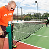 John P. Cleary | The Herald Bulletin<br /> Dennis Poe, left, cranks up the net as Carl Bowen measures it's height as they help install new tennis nets on the resurfaced Anderson University courts Tuesday afternoon.  They are prepping for the 37th annual Community Hospital Anderson Tennis Classic which starts this Saturday and runs through the 19th.